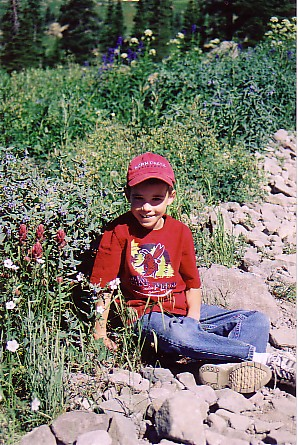 Ouray trip 05 Matthew by the flowers.jpg