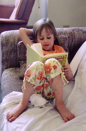 Ouray trip 05 Sophie reading My Fathers Dragon in condo.jpg