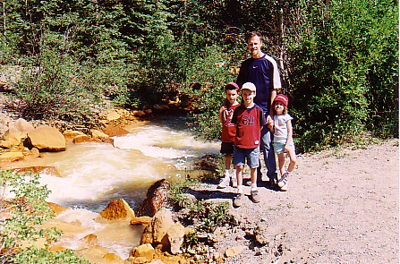 Ouray trip 05 family beside red mtn creek.jpg